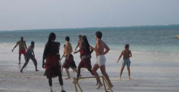 Playing Football at the beach zanzibar accommodations deals